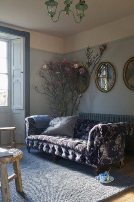 lifestyle image of Loopy Rug - Various Colours & Sizes with blue patterned sofa, round mirrors on the wall and roses in corner