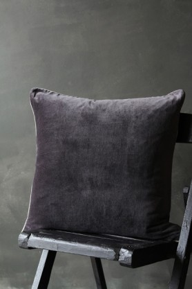 lifestyle image of Luxury Velvet Cushion - Slate Grey on black wooden chair and grey wall background
