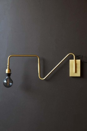 lifestyle image of Matt Brass Contrast Directional Wall Light With Rectangle Back Plate on dark wall background