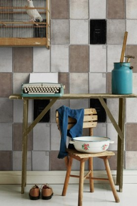 lifestyle image of Mind The Gap Book Covers Wallpaper with wooden desk and chair with blue typewriter and vase with wooden shelf on wall