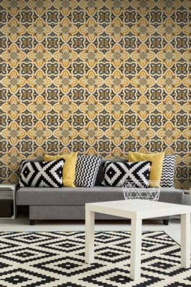 lifestyle image of Mind The Gap Maghreb Tile Wallpaper with grey sofa with yellow and black and white cushions and white side table on black and white rug