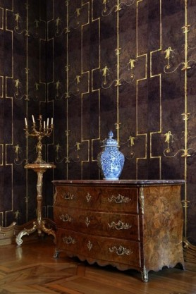 lifestyle  image of Mind The Gap The World Of Antiquity - The Swan Wallpaper - Dark with wooden chest of drawers with blue vase and coat stand