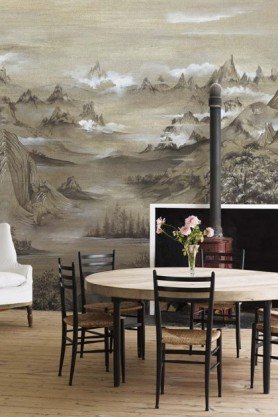 Lifestyle image of the Mountains Wallpaper Mural - Kami Maca in dining room with round table and black dining chairs on wooden floor