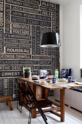 lifestyle image of Mr Perswall Wallpaper - Communication Collection - Writers-Thinking In Ink P132301-4 with layed wooden dining table with breakfast and dining chairs on white tiled flooring and black shade ceiling light