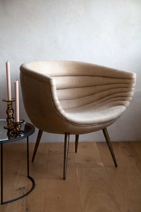 Side angle lifestyle image of the Soft Leather Round Back Armchair
