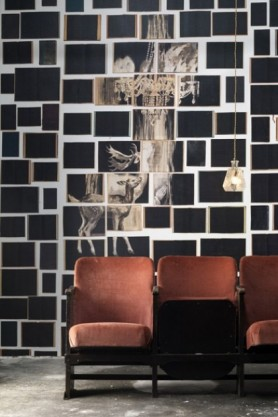 lifestyle image of NLXL EKA-05 Biblioteca Wallpaper by Ekaterina Panikanova - Mural 5: Deer with three brown chairs and black cushion