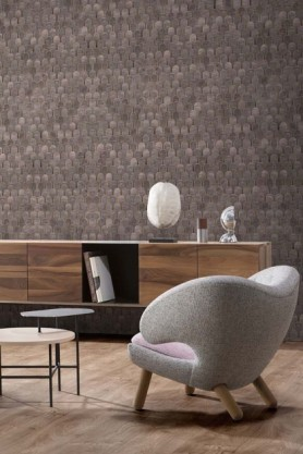 lifestyle image og NLXL Nizwa Wallpaper by Bethan Gray - 3 Colours Available with wooden table and grey armchair with side table
