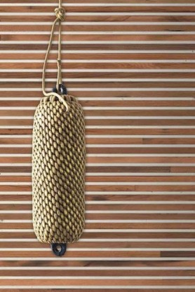 lifestyle image of NLXL TIM-02 Timber Strips Wallpaper by Piet Hein Eek with rattan ceiling light