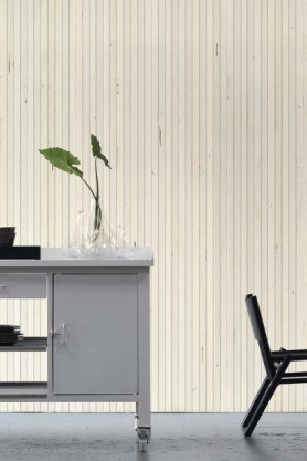 lifestyle image of NLXL TIM-07 Timber Strips Wallpaper by Piet Hein Eek with white desk with plant and black chair