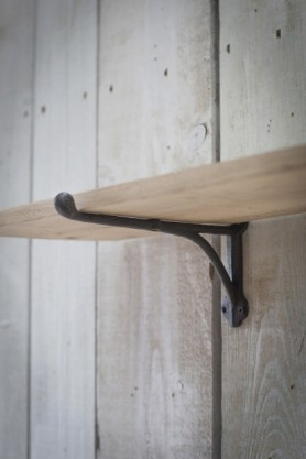 detail image of bracket on Oak Shelf With Cast Iron Brackets - Large on white wood panel wall background