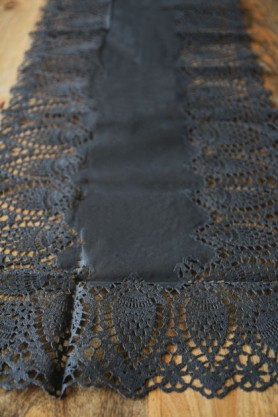 lifestyle image of Outdoor Crochet Table Runner - Black on wooden table