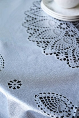 detail image of Outdoor Vinyl Lace Crochet Tablecloth - Silver with white plates stacked on top