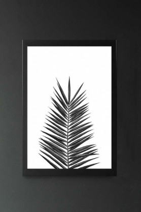 lifestyle image of Palm Leaf Art Print By Nika in black frame on dark wall background
