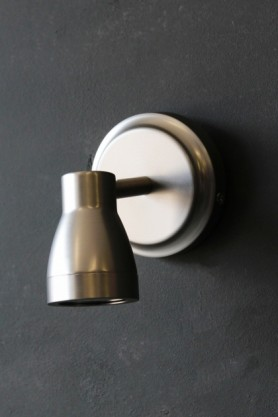 lifestyle image of Putney Bathroom Spot Light - Satin Nickel on dark grey wall background