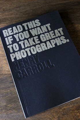 lifestyle image of cover on Read This If You Want To Take Great Photographs on wooden surface background