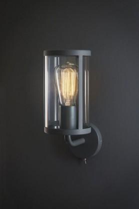 Grey cadogan wall light on a black wall lifestyle image