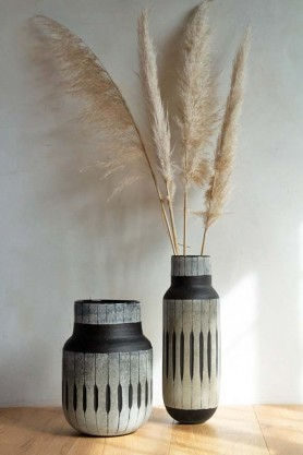Lifestyle image of both the African Tribal Inspired Vases with pampas grass displayed