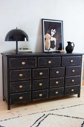 Angled close-up lifestyle image of the Antique Style Black Multi-Drawer Storage Cabinet