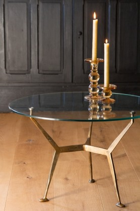 Lifestyle image of the Antique Brass Glass Top Round Coffee Table