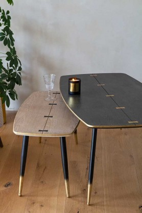 Lifestyle image of both the Natural and Black Art Deco Mid-Century Modern Coffee Table