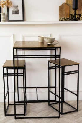 Front on lifestyle image of the Black & Gold Bar Set With Bar Table & Two Bar Stools
