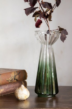 Lifestyle image of the Fresh Green Glass Bulb Vase with stems
