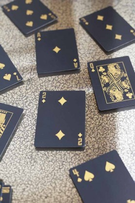 Image of the Black & Gold Playing Cards scattered on a table