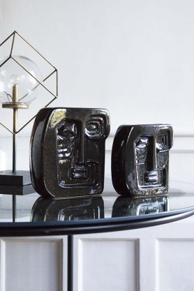 Lifestyle image of both sizes of Gloss Black Abstract Face Vases