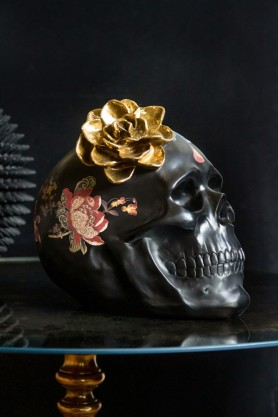 Lifestyle image of the side of the Black Feminine Skull With Gold Flower Ornament