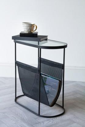 Lifestyle image of the Black Lozenge Shaped Glass Side Table With Magazine Rack