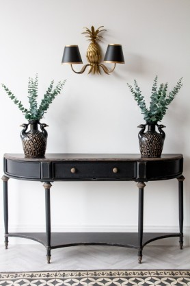 Front-on lifestyle image of the Black Vintage Style Metal Distressed Console Table With Drawer
