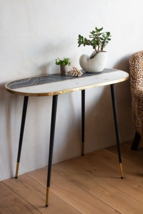 Lifestyle image of the Black & White Marble Brass Oval Console