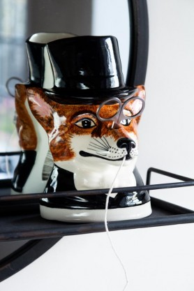 Lifestyle image of the Hand Painted UK Made Fox String & Scissor Holder sitting on a mirror with shelf