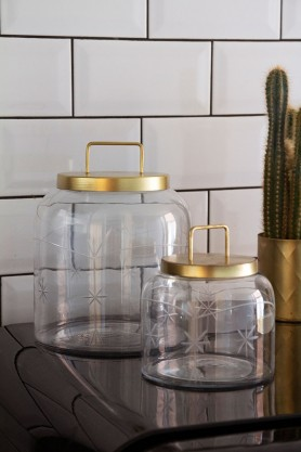 Lifestyle image of both the small and the large Cut Glass Storage Jar & Gold Lid