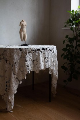 Lifestyle image of the Bohemian Rose Crochet Throw/Tablecloth on a table
