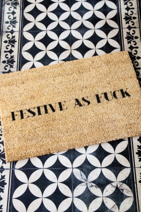 Lifestyle image of the Festive As Fuck Christmas Doormat
