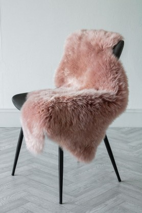 Image of the Pink Genuine Sheepskin Rug on a chair