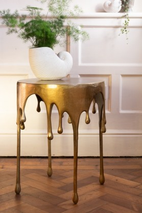 Lifestyle image of the Gold Drip Coffee Table