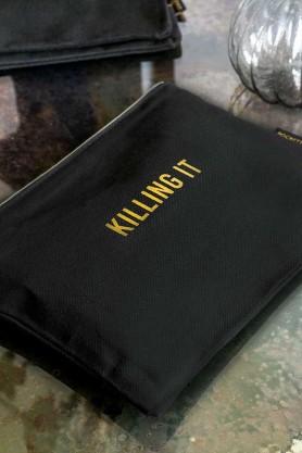 Lifestyle image of the Black Cotton Killing It Pouch Wash Bag