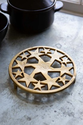 Lifestyle image of the Gold Stars Trivet