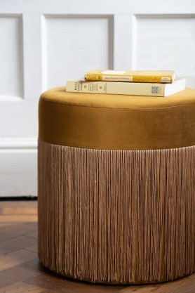 Lifestyle image of the Gold Velvet Fringed Pouffe Foot Stool