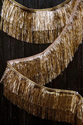 Lifestyle image of the Gold Fringe Layered Tinsel Party Garland