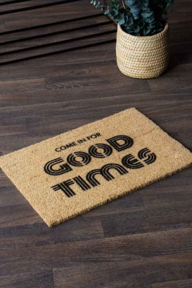 Lifestyle image of the Come In For The Good Times Doormat