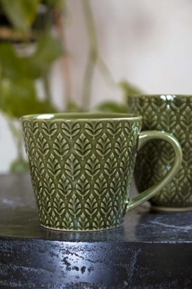 Lifestyle image of the Moss Green Fern Leaf Design Mug