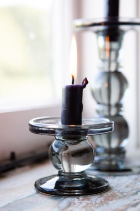 Close-up image of both the Tall & Short Grey Smoked Glass Traditional Style Candle Stick Holder on a windowsill