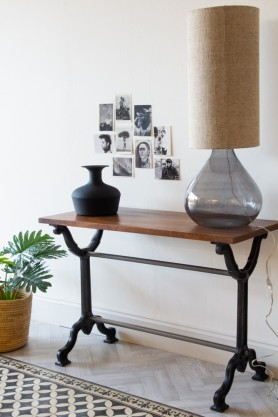 Lifestyle image of the Industrial Cast Iron Console Table With Wooden Top