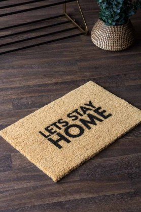 Lifestyle image of the Let's Stay Home Doormat