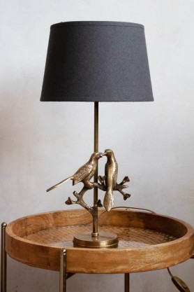 Lifestyle image of the Love Birds Table Lamp With Charcoal Lamp Shade on round table
