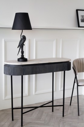 Angled lifestyle image of the Mango Wood & Marble Dark Oval Console Table