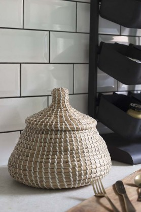 Lifestyle image of the Seagrass Basket With Lid